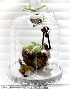 Cloche, Whites with a touch of Lime & Silver. Real rescued bird nest, antique skeleton keys, mercury glass heart.