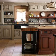 cabinet color, separate island/workstation, built in cabinets, second sink, farmhouse sink, everything basically.