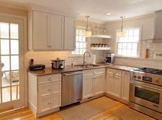 Cape cod kitchen. Super cute. It has it all and so small :)