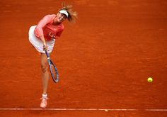 Mutua Madrid Open - Day Two - Maria Sharapova of Russia serves against Timea Bacsinszky of Switzerland in their second round match during day one of the Mutua Madrid Open tennis tournament at the Caja Magica on May 3, 2015 in Madrid, Spain.