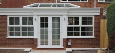 Bespoke uPVC Orangeries that enhance and extend your home. Fitted with modern high performance glass ensures you can use your Orangery all year round. Upvc French Doors, Sutton Coldfield, West Midlands, New Builds, Garage Doors, New Homes, Dining Room, Windows, Building