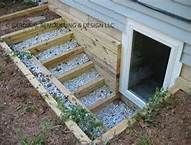I like the way this is tiered. More light, better view for a larger basement window. Egress Windows