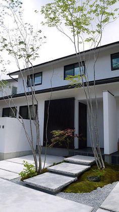 住友林業緑化株式会社 | 個人のお客様 | 実例紹介 | シンプルな白壁とやわらかい植栽の対比で魅せる