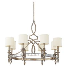 Cast a warm glow over your dining room or entryway with this glamorous chandelier, featuring silver and gold leaf finishes paired with fabric drum shades.