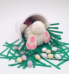How to make a cute pom pom bunny centerpiece, inspired by the bright spring light, fresh colors and all out cuteness of Easter bunny craft season