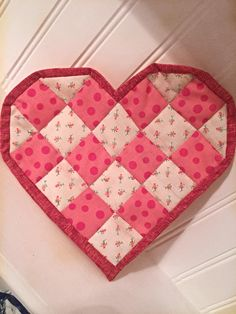 Quilted heart-shaped candle mat mug rug by DowneastTraditions