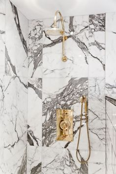 Marble slab shower with brass fixtures