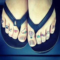 I had wanted more picture tattoos, as most of mine are lyrics or phrases I live by, and I came to the idea of tattooing my toes with symbols for all the things I love. I couldn't be more happy with my toes. Done by Chubbs at Bombs Away I in Jacksonville, NC.