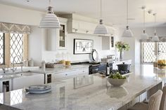 Love the pendant light shades, cabinets & overall look. | Neptune