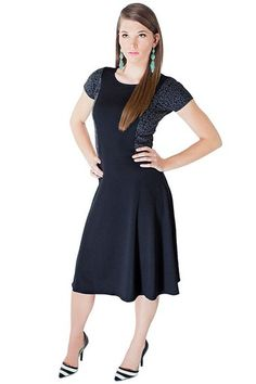 """""""Katy"""" is constructed with stretchy ponte fabric, we love how it's a pull over dress with no fussy buttons or zippers!"""