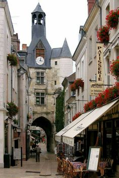 the 'Tour de l'Horloge' (clock tower) presides over this street in charming Amboise