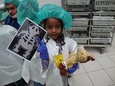 Child at the 'Teddy Bear Hospital' with a teddy x-ray