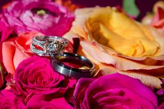 Rings with Coral, Pink, & Yellow Flowers. http://celebrationsoftampabay.com/wedding-photographers-tampa/