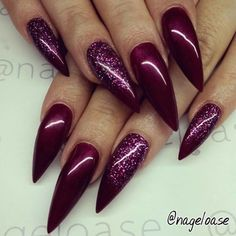 Easy stiletto nail design - solid burgundy polish with glitter. Simple and easy stiletto nails.
