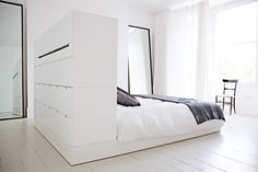 Divider/storage headboard... Great for deep rooms w tall ceiling