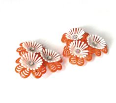 Huge Orange and White Plastic Flower Clip Earrings Retro Mid Century 1950s 1960s Bold Bright Colorful Aurora Borealis Rhinestones Vintage by VintageByBelle on Etsy https://www.etsy.com/listing/269971196/huge-orange-and-white-plastic-flower