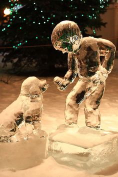 Saint Paul Winter Carnival, Ice sculptures. A boy and his dog.