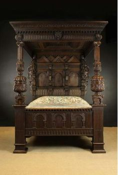 A Magnificent 17th Century & Later Carved & Inlaid Bed Full Tester Bed incorporating early elements. The panelled tester richly ornamented with chip carved geometric bands framing relief carved Tudor roses, and guilloche plaits of flower heads surrounding a recessed centre panel with pyramidal pendant finial. The cornice adorned with acanthus, dentil moulding and gadrooning with an armorial shield to the centre and lion masks each end. #HomeAppliancesSleep