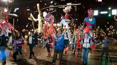 People converge on the streets in Binghamton, NY, to ring in the New Year at the Annual First Night Parade.