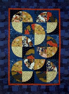 African quilt - TheFind.  This is a beautiful quilt!  The pattern reminds me of the phases of the moon in the night sky.