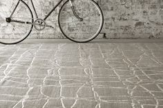 Hand knotted in a superb combination of subtle tonings, The Melrose Collection of rugs feature a refined luxe look with elegant patterns that are highlighted in luscious bamboo silk. A combination of cut and loop pile add interest, life and texture to this stunning collection. Shown here is Urban in Platinum.