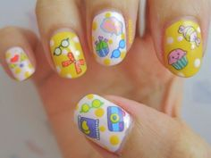 You can make animal or fruits which are wearing glasses and this designing will give your hands eye-catching look. Frog wearing glasses Nail Art Designing
