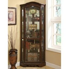 950175 Darby home co ferron rich brown finish wood corner curio glass front cabinet with glass shelves and rounded top. This cabinet features a corner shape to fint in that empty corner in the room to display your collectibles, and moveable glass shelves Coaster Fine Furniture, Dining Furniture, Furniture Ideas, Brown Furniture, Furniture Makeover, Furniture Design, Corner Curio, Corner Bar, Corner Shelf