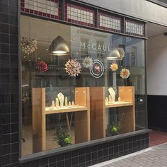Spring has sprung and our seasonal window display is hung! #paper #dahlias…