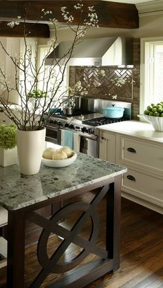 like the creamy cabinets, dark floors and wood island by ursula