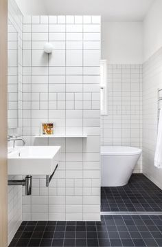 White tile bathroom and bathroom flooring tile with black ceramic floor tile plus floating sink will complement decorating small bathroom Modern Small Bathrooms, Small Bathroom Tiles, Bathroom Toilets, Bathroom Layout, Simple Bathroom, Modern Bathroom Design, Bathroom Flooring, Bathroom Interior, Shower Tiles