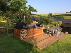 A stunning outdoor barbecue in the Devon countryside with a fantastic backdrop.