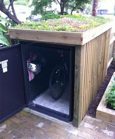 Integral bike security in the garden from Asgard - bike locker with rooftop garden – only instead, a kayak shed with a green roof! Garden Bike Storage, Outdoor Bike Storage, Shed Storage, Storage Units, Kayak Storage, Small Storage, Small Garden Storage Ideas, Small Garden With Shed, Outside Bike Storage