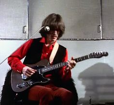 George and his custom rosewood Telecaster. I love that guitar...almost as much as I love Georgie. Almost.