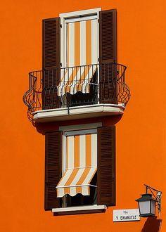 Orange. Wall. Shades.