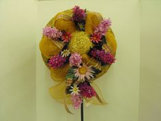 Yellow deco mesh with lavender/pink silk flowers