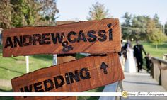 Photo of bridal party behind their ceremony sign - (c) Brittany Erwin Photography