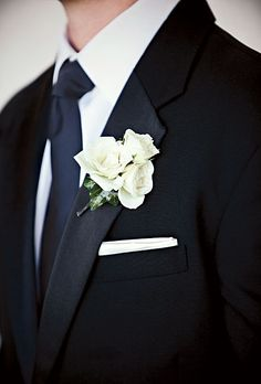 Brides: Classic White Rose Boutonniere . The groom wore a white rose boutonniere. All floral design was by Wedding Flowers by Lisa.