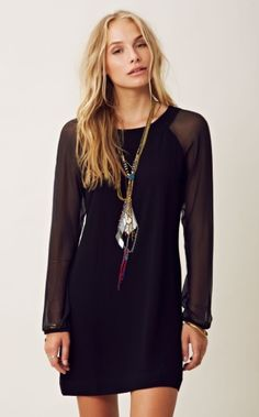 Sheer Long Sleeve Short Black Dress.  Does anyone know where to buy this dress?