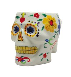 Dia De Los Muertos White Skull. Celebrate Dia De Los Muertos - The Day of the Dead - with this decorative White Skull Mug. Made of ceramic, this skull is painted to look like one of the colorful sugar skulls given out on Mexico's famous holiday honoring the dead. A fun gift for anyone with a positive outlook on the end of life, this skull looks awesome on any table or desk. http://www.zocko.com/z/JFwS2