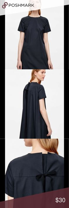 """COS Women's Navy Cotton Short Sleeve Dress Size 4 Adorable a-line dress from COS.  Made from crisp cotton-mix poplin with a grosgrain tie fastening on the back. An A-line fit, it has in-seam pockets, neat short sleeves and a subtly graduated curved hem. 75% Cotton / 21% Polyamide / 4% Elastane.  Machine washable   Measures:  38"""" chest  52"""" waist  54"""" hip  34"""" length(2"""" inch hem allowance)  8"""" sleeve COS Dresses"""