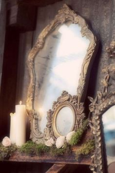 Love these ornate but subtly metallic mirror frames all stacked up.