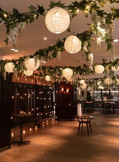 Festoon backdrop plus free-standing ceiling installation dressed with foliage, wisteria, lanterns and pealights for a wedding at Devonshire Terrace Wedding Ceiling Decorations, Prom Decor, Wedding Lanterns, Paper Lantern Wedding, Chinese Lanterns Wedding, Ceiling Draping Wedding, Wedding Reception Decorations On A Budget, Wedding Ideas, Enchanted Forest Prom
