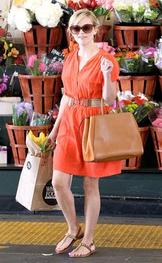 Garden Fresh from Reese Witherspoon's Street Style No wall flower here! The blond star hits up the flower shop in a juicy mandarin dress paired with oversized shades.