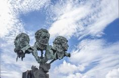 The three poets sculpture at Autonomy Bridge roundabout. By sculptor Luis Martinez Giraldo
