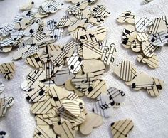 Sheet music cut into hearts (or whatever). For confetti to throw as the couple leaves after the reception, or for the tables.
