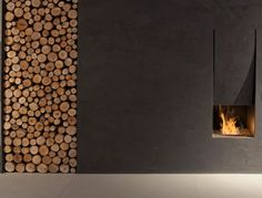 'Il Canto del Fuoco' fireplace by Domenico De Palo and Antonio Lupi - There's something incredibly soothing and communal, primal even, about warming yourself next to merrily crackling flames. More so when the flames are contained within a fireplace as discretely unobtrusive yet structural as this one.