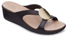 Hammered faux-metallic disc embellishments add an artisanal touch to these flips while the wedge provides a little extra lift. Shop these women's wedge flip flops.
