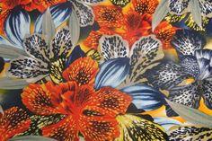 Voor maxi-jurk of jumpsuit. Linnen stof, tropische bloemprint, blauw, geel en oranje-bbms.nl - Bas Bastiaans