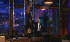 Heidi Klum flashes her bare thigh in ultra-sheer dress on The Tonight Show... then dances on Jay Leno's desk