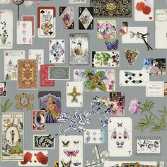 Maison de Jeu Wallpaper A luxurious wallpaper adorned with multicoloured antique playing cards set against a grey ground. Maison de Jeu means 'gaming house' or 'house of cards'.